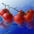图库照片: Tomatoes on glass