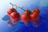 Tomatoes on a glass — Stock Photo