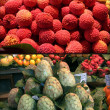 Exotic fruits. Lichee. Cherimoya. City market Bokerija - Stock Photo