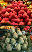 Exotic fruits. Lichee. Cherimoya. City market Bokerija — Stock Photo