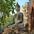 The ruins of the ancient city. Buddha statue. — Stock Photo