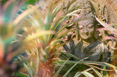 Asian statue in the garden. — Stock Photo