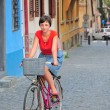 Woman on retro bike — Stock Photo #12114245
