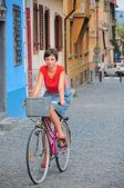 Woman on retro bike — Stock Photo