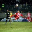 Football match between ARIS F.C. and OLYMPIAKOS F.C. — Stock Photo #14840985