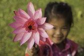 Girl and lotus — Stock Photo