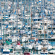 Busy harbor with lots of boats. - Stock Photo