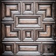 Stock Photo: Old wooden door with carved geometric pattern.