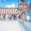 Visitors in line at Louvre pyramid. - Stock Photo