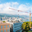 Construction crane in Monte Carlo, Monaco. - Stock Photo