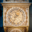 Old golden clock in Lyon, France. - Stock Photo