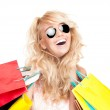 Beautiful and happy young woman with shopping bags. — Stock Photo