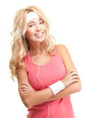 Sporty girl in headphones on white background. — Stock Photo