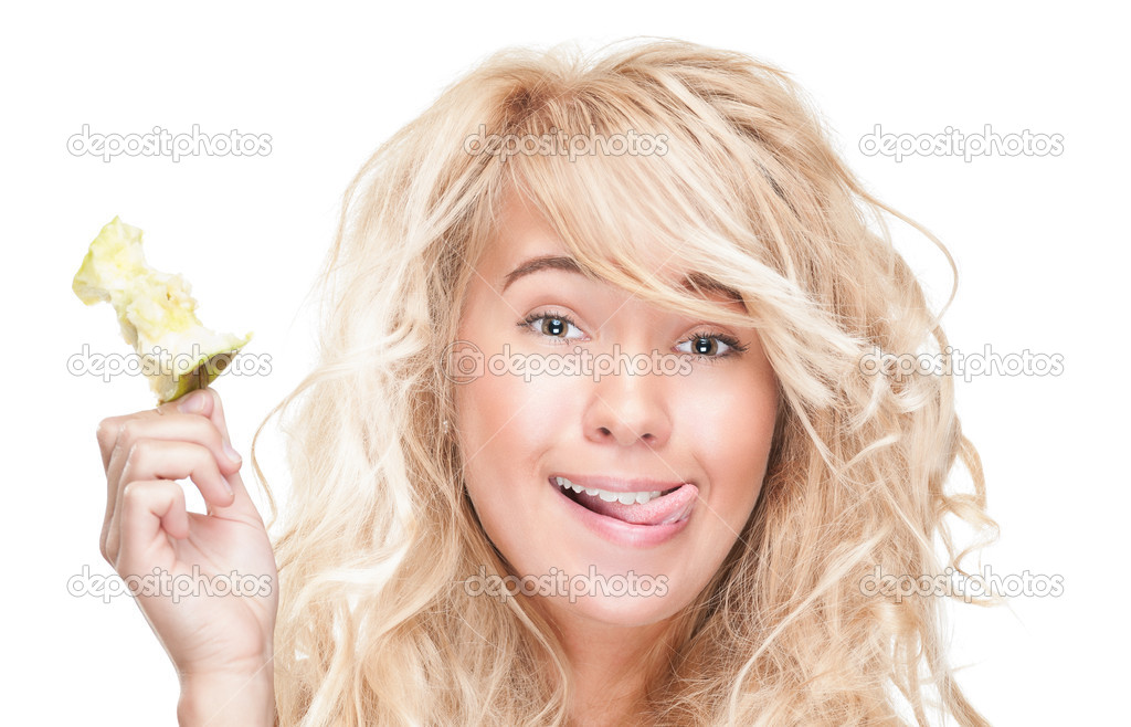 Pretty woman with beautiful hairstyle isolated on white background. Young girl holding apple core and laughing. Positive person with happy facial expression. — Stock Photo #13204694