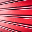Abstract background of red metal stripes. - Stock Photo