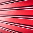 Abstract background of red metal stripes. - 