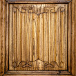Old door of wood with patterns carved on it. — Stock Photo