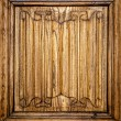 Stock Photo: Old door of wood with patterns carved on it.