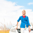 Tourist woman in front of car in summer field. — Stock Photo #14753865