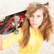 Portrait of pretty girl with skateboard outdoor. — Stock Photo