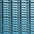 Seamless blue background of server disk storage. - Stock Photo