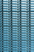 Seamless blue background of server disk storage. — Stock Photo