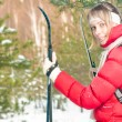 Young woman skiing in forest on winter sunny day. - Stok fotoğraf