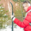Young woman skiing in forest on winter sunny day. — Stock Photo