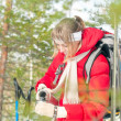 Woman wearing sport red jacket in winter forest. - Stok fotoğraf