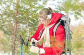 Woman wearing sport red jacket in winter forest. — Stock Photo