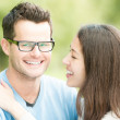 Portrait of happy young man and woman in park. — Stock Photo #21507189