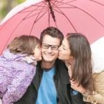Portrait of happy family of three outdoor. — Stock Photo