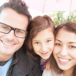 Close up portrait of happy family of three. — ストック写真