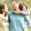 Happy family of three having fun outdoor. — Stock Photo