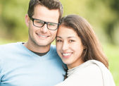 Portrait of happy young man and woman in park. — Stock Photo