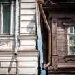 Two houses in Russia: old wooden and brick. - Stock Photo