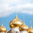 Golden domes of russian church against blue sky. — Stock Photo #21590611