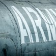 Side view of military plane with inscription. - Stock Photo