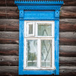 Window of old traditional russian wooden house. — Foto de Stock