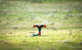 Garden watering system with spiral sprays. — Stock Photo