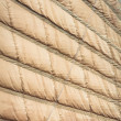 Light brown sail of vietnamese boat close up. - Stock Photo