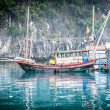 Floating fishing boat. Halong Bay, Vietnam. - Stockfoto