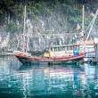 Floating fishing boat. Halong Bay, Vietnam. - Stock Photo