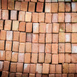 Wall of new red bricks stacked in rows. — Stock Photo #22223323