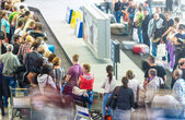 Lots of getting luggage at airport. — Stock Photo