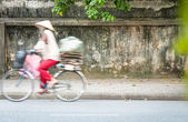 Person riding bicycle on road in Vietnam, Asia. — Stock Photo