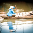 Woman on wooden boat in river in Vietnam, Asia. — Stock Photo