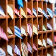 Rows of shelves with colorful ties at shop. - Stock Photo