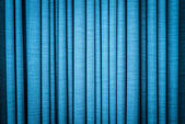 Blue curtain in folds. Textured background. — Stock Photo