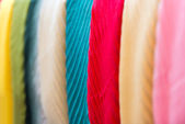 Row of new multicolored scarves at shop. — Stock Photo